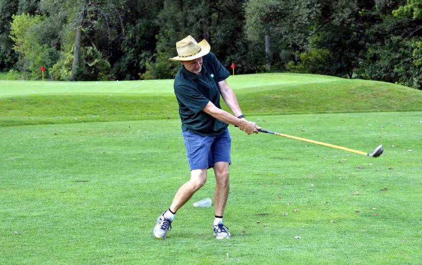 Man following through in a golf swing