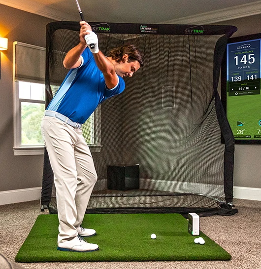 Man swinging with a SkyTrak Home Golf Simulator Package