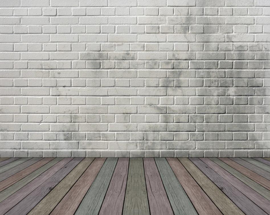 Empty room - wood floor and brick wall